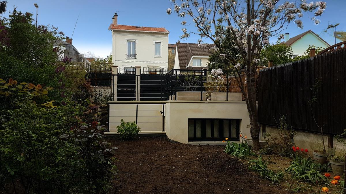 Photo après de la construction d'un parking et d'un atelier à Paris pour un particulier