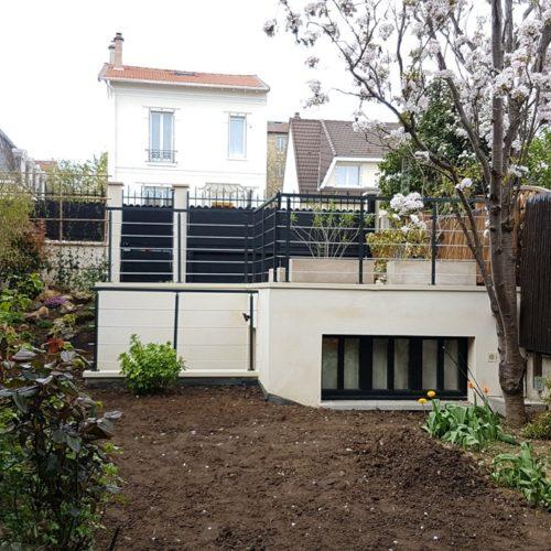 Photo couleur d'un garage et un atelier construit pour des particuliers par l'équipe de TB'Home Architecteurs