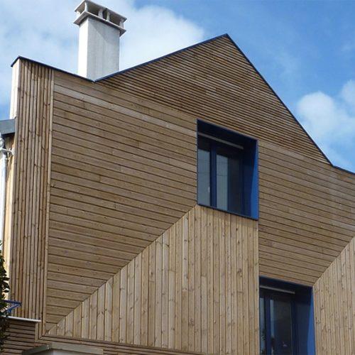 Photo couleur d'une rénovation de maison contemporaine en bois réalisée par TB'Home Architecteurs