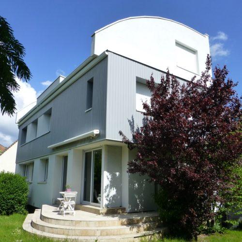 Après rénovation et extension d'une maison ancienne parisienne par TB Home Architecteurs